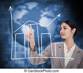 Brunette businesswoman working with graphical presentation ...