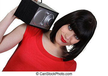 Brunette carrying radio over shoulder