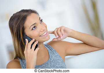 Brunette chatting away to a friend on her mobile