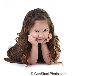 Brunette Child With Mischievious Expression on White Background With Copyspace