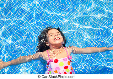 brunette children girl swimming blue tiles pool