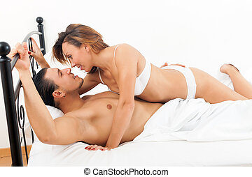 Brunette couple having sex