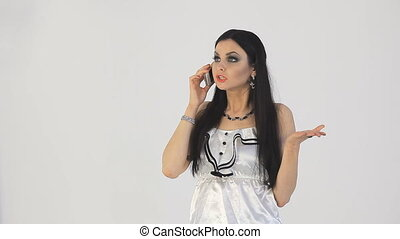 Brunette cries on the phone.  white background