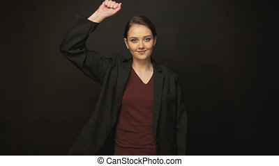Brunette dancing woman in black jacket