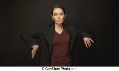 Brunette dancing woman in jacket