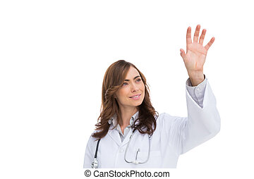 Brunette doctor reaching for something in the air