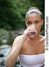 Brunette drinking glass of water