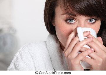 brunette drinking warm beverage