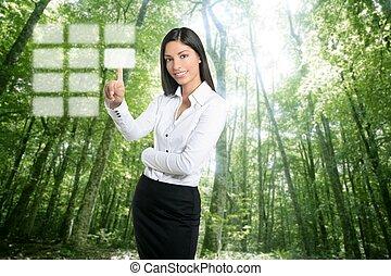 Brunette ecological businesswoman touch keypad - Brunette...