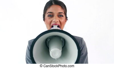 Brunette executive shouting in a megaphone