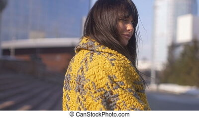 Brunette female smiling on city background