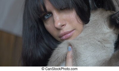 Brunette female with a cat - Brunette female with blue eyes...