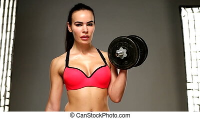 brunette female woman with weights