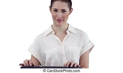 brunette, femme affaires, regarder, quoique, appareil photo, dactylographie