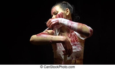 Brunette girl bandaging wounds - Footage of bandaging woman...