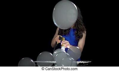 Brunette girl blowing smoky soap bubbles