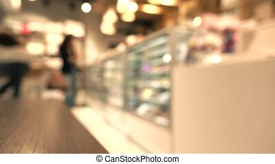 Brunette girl choosing chocolates in pastry shop. 4K...
