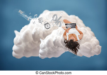 Brunette girl connected to cloud computing and using many...