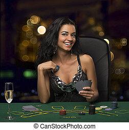 brunette, girl, dans, les, casino, poker jouant, bokeh