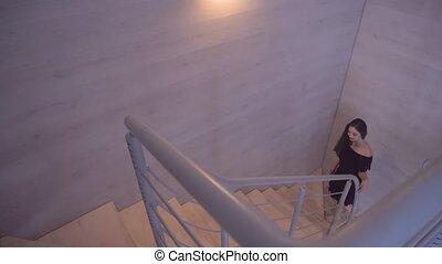 Brunette Girl Goes Upstairs