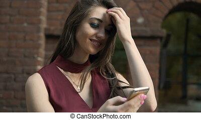 Brunette Girl Holding Smartphone