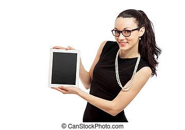 brunette girl in black dress holding ipad over white...