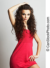 Brunette girl in red dress in red