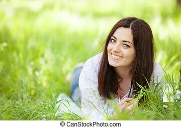 Brunette girl in the park.