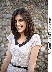 girl in white dress smiling
