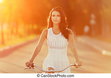 brunette girl on bicycle