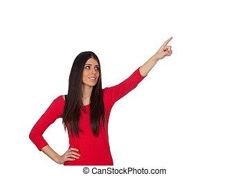 Brunette girl pointing something with her finger