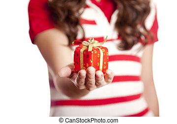 Brunette girl show you present box.