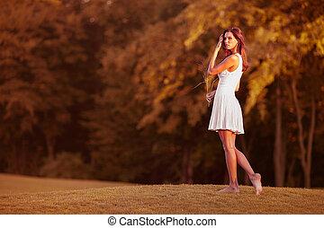 brunette girl walking in park