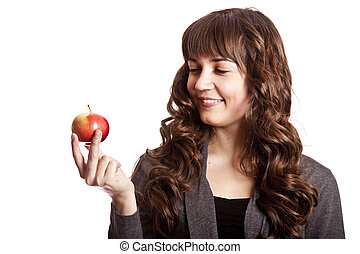 Brunette girl with apple in hand.