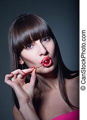 Brunette girl with cherry