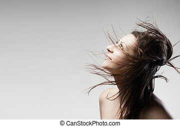 brunette girl with hair in the air