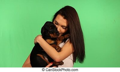 Brunette girl with her doberman pup