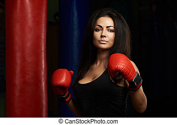 Brunette girl with red boxing gloves