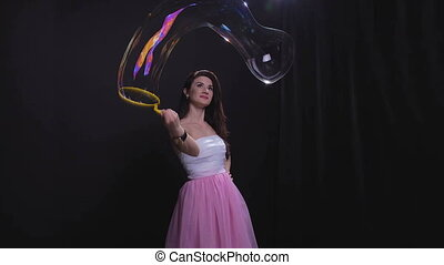 Brunette girl with soap bubbles