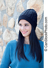 Brunette girl with wool cap and piercing