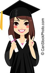 Beautiful brunette girl on graduation day holding diploma and making victory sign hand gesture