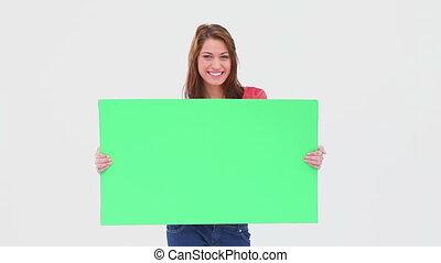 brunette, haired, vasthouden, poster, leeg, vrouw