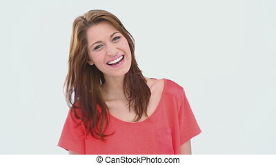 Brunette haired woman laughing