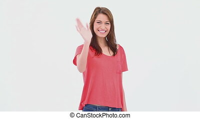 Brunette haired woman waving her hand