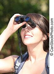 Brunette hiker with binoculars