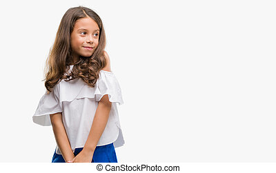 Hispanic girl look on side on blurred natural background