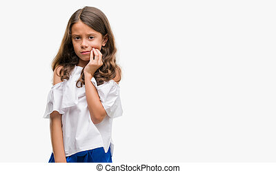 Brunette hispanic girl touching mouth with hand with painful...