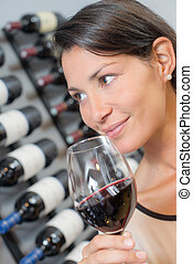 Brunette holding a glass of wine