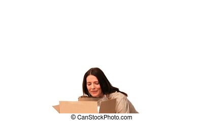 Brunette holding boxes isolated on a white background