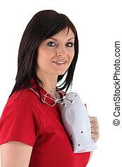 Brunette holding electric whisk
